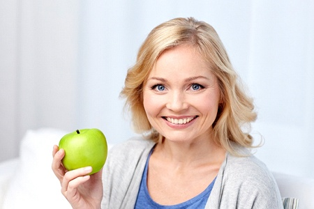 Enjoying apple with help of All-on-4 dental implants