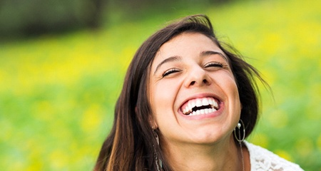 attractive woman brown hair smiling after dental bonding treatment