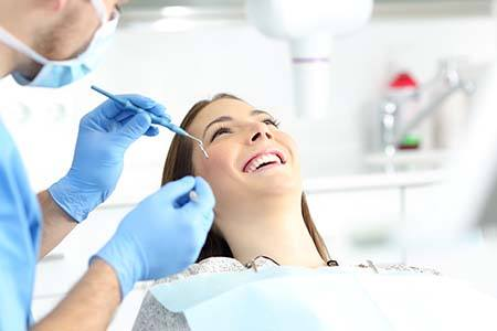 dentist showing a patient their X-ray during dental checkup