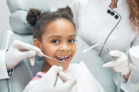 child getting their teeth cleaned