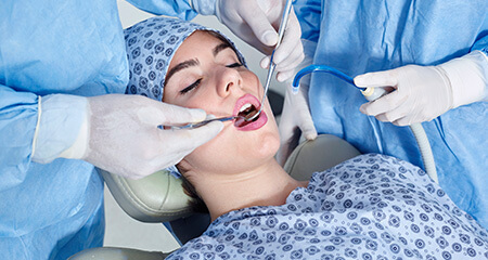 Relaxed patient receiving dental care under I V sedation dentistry