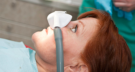 Patient with nitrous oxide sedation dentistry mask