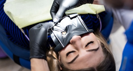 A patient preparing for a root canal
