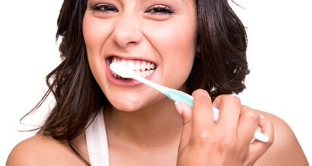 attractive woman brunette brushing teeth
