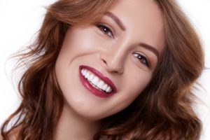 Woman with a beautiful smile using cosmetic dentistry